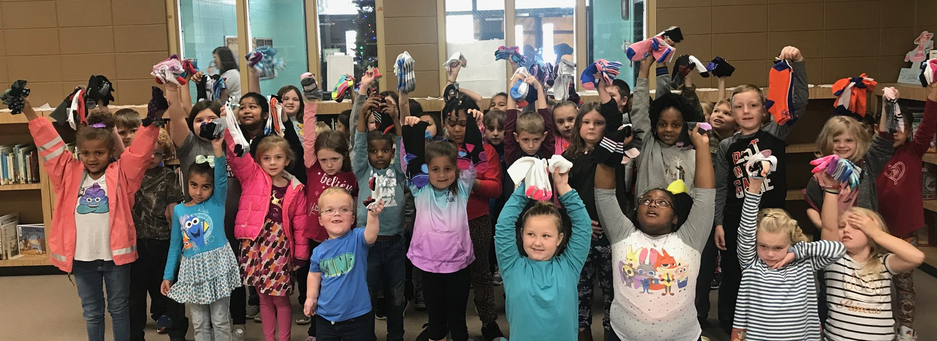 First-graders received socks from Delta Sigma Theta Sorority.